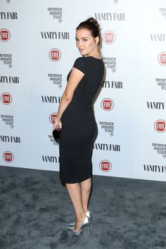 Camilla Luddington in a little black dress and silver high heels