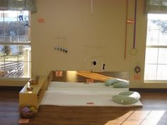 I love the beauty and simplicity of an infants room based on Montessori ideas!