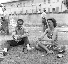 Italian director and scriptwriter Michelangelo Antonioni and French actress and singer Jeanne Moreau relaxing on the set of The night. Milan, 1960