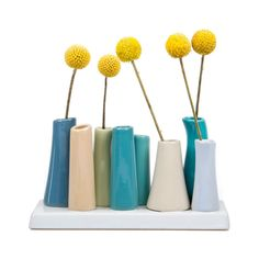 This stunning set contains eight glazed ceramic vases of varying heights and colors attached to one round-edge base. Fill all of them with your favorite flowers, only one, or none at all. Its romantic ...  Find the Flower Power 8-Vase Display, as seen in the Countdown to Sputnik Style Collection at http://dotandbo.com/collections/countdown-to-sputnik-style?utm_source=pinterest&utm_medium=organic&db_sku=CHV0060