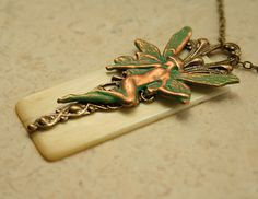 Upcycled Ivory Piano Key Necklace with a Fairy; from DesignsBloom@etsy