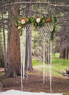 33 Boho Wedding Arches, Altars And Backdrops To Rock: hanging macrame backdrop with flowers looks ethereal Flower Backdrop, Ceremony Backdrop, Ceremony Decorations, Rustic Bohemian Wedding, Woodland Wedding, Rustic Weddings, Autumn Weddings, Hippie Chic Weddings, Bohemia Wedding