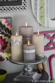 up your candles with this easy DIY! Wrap standard-issue pillars with metal ribbon—use nails or pushpins to secure— and fan the flames of gorgeousness. Grey Candles, Pillar Candles, Deco Led, Pewter Art, Candle Craft, Creation Deco, Deco Table, Candle Lanterns, Candle Making