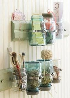 Think twice before throwing your old jam jars in the recycle bin. Transform them into hanging ornaments filled with flowers or tealights. Hang them at different heights above your table to free up space for plates or outside from a tree branch. You'll need wire coil and pliers to shape the wire around the neck of the jar and make a handle.