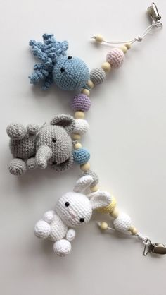 Crochet stroller chain with squid, elephant and rabbit Crochet stroller chain with squid, elephant and rabbit Source by katjahueper Crochet Baby Mobiles, Crochet Baby Toys, Newborn Crochet, Crochet Gifts, Knit Crochet, Baby Knitting Patterns, Crochet Patterns, Crochet Baby Jacket, Baby Barn