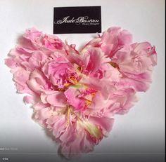 A heart of peony petals .