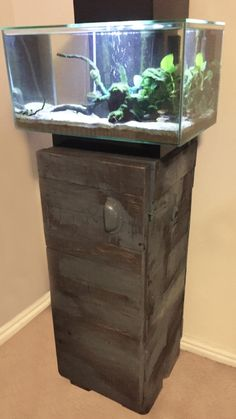 Aquarium cabinet made from reclaimed pallet wood, with a dark oak stain and distressed oil paint effect. #cabinet #palletfurniture #upcycledfurniture #upcycling