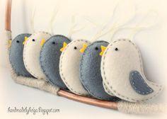 Four sets of felt birds