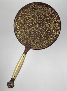 Mirror with split-leaf palmette design inlaid with gold, Ottoman period (ca. 1299–1923), early 16th century Turkey, probably Bursa or Istanbul Iron, inlaid with gold; ivory