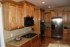 oak kitchen cabinets- tan walls (these countertops and floors are really similar to ours as well)