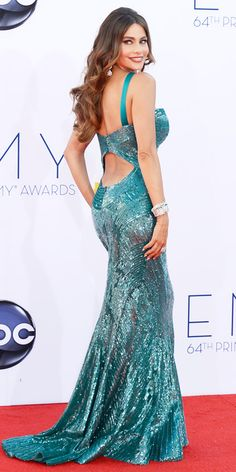 The 28 Sexiest Emmys Looks of All Time - Sofía Vergara, 2012 in a hand-beaded Zuhair Murad mermaid gown. The look featured a reverse halter neckline and an open back. Fergana accessorized 175 carats of Neil Lane jewels from the Diamond Hollywood collection.