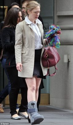 """Chelsea Clinton and her """"bare"""" walking boot."""