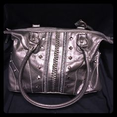 Faux leather purse studs rhinestones silver pewter This adorable purse has been used but lots of love left. Very little signs of wear mostly on the inside (there are some pink stains on the inside liner). It's a pewter like silver, has pyramid studs, circle studs, and rhinestones. Chic yet slightly rocker chick. Maurices Bags