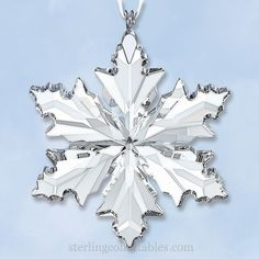 """2014 Annual Snowflake Ornament, this delicate snowflake sparkles in clear crystal. The 2014 Swarovski Mini Snowflake Crystal Ornament includes original gift box and measures 2"""" high. The ornament itself is not dated."""