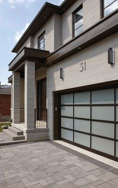 Contempo presents a chic blend of smooth surfaces, clean lines and a linear feeling for today's design trends. Exterior House Colors, Exterior Design, Brickwork, Stone Houses, Curb Appeal, Design Trends, Beautiful Homes, Modern Design, New Homes