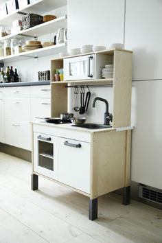 IKEA Fan Favorite: DUKTIG mini-kitchen. This pint-size kitchenette encourages role play and has cooktop lights that give a realistic glow but do not get warm. This fan fave can also grow with your child! The height of the legs can be adjusted to three positions.