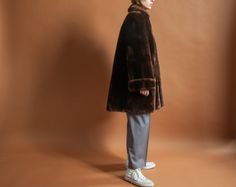 vintage 1960s heavy weight and thick mutton fur coat. peter pan collar. pockets at waist. two hook closures at center. lined. (2102o-1.5.2.R4)  materials: mutton fur condition: excellent size: fits like a small - medium (shown on a small) (not pinned)  (outside of coat) shoulders: around 18 bust: 38 waist: 46 hips: 54 length: 34 sleeve length: 25   *measurements are taken seam to seam while lying flat *doubled for bust, waist, and hips. *model is a small, around 58   *free U.S. shipping on…