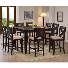 """Metro 5-Piece Pub Set  $499.99 Set  Dark walnut finish  Table extends 36"""" - 54"""" with removable leaf  Sunburst oak veneer table top  Clipped corner table top and tapered leg  Stools feature X-back design  Generous cushioned stool seats in neutral taupe  Set includes table & 4 padded chairs  Extra chairs sold separately  Table Size: 54""""W x 54""""D x 36""""H  Stool Size (each): 21""""L x 19.5""""W x 41""""H"""