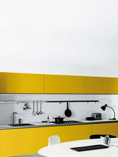 yellow & white minimal kitchen!!! YES! It just needs a touch of cobalt blue.