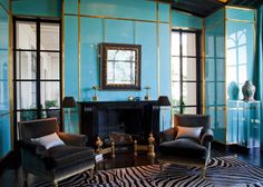 In this West Coast home, the library's 90 turquoise Chinese lacquer panels were fabricated in the U.S., then sent to Paris for finishing; the banding is gilt bronze.