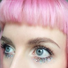 Pastel pink hair and lovely sparkly eye makeup!