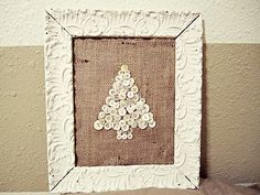 white button christmas tree in shabby chic white frame with burlap background