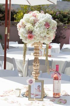 Centerpieces at a pink and gold baptism party! See more party ideas at CatchMyParty.com!
