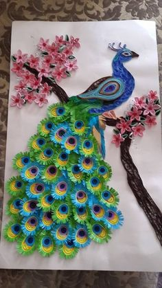 blue and orange peacock quilling piece in circle You are skilled (& patient!Stunning peacock made of quilled paper. Quilling is the art of paper rolling. Peacock Quilling, Peacock Crafts, Arte Quilling, Paper Quilling Patterns, Quilled Paper Art, Quilling Paper Craft, Quilling Flowers, Paper Crafts, Quilling Ideas