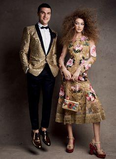 Shining in gold, Gigi Hadid models Dolce & Gabbana dress, earrings, bag and sandals