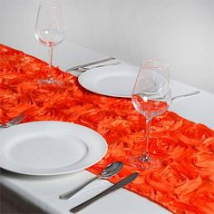 Wonderland Rosette Table Runners - Orange |  Add oodles of flair and character in your party with our enticing raised rosette table runner, which is simply breathtaking. The very sight of this floral ecstasy will bring the divine vision of a paradise garden with its whimsical blossoms and luster into your event/celebration. For those special and rare celebrations that need to have an extra doting touch in their ambiance decoration, this top-notch rosette linen is a picture perfect choice…