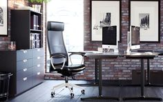 An office with BEKANT desks and MARKUS chairs in sophisticated black.