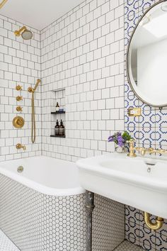 Tiles are mixed with different textural elements, a touch of antiques, and some midcentury-modern hints.