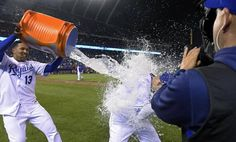 Kansas City Royals' Alex Gordon (4) couldn't dodge the celebratory shower from Salvador Perez after the teams 7-1 win over the Cincinnati Reds during Wednesday's baseball game on May 20, 2015 at Kauffman Stadium in Kansas City, Mo.
