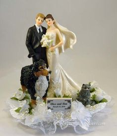 Customized Australian shepherd and long haired cat with bride and groom wedding cake topper. Shown in white with ivory accents. Personalized hair color changes on bride and groom. Includes name and wedding date plate.  http://www.affectionately-yours.com/yours-mine-and-ours-wedding-cake-topper/