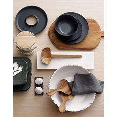 black, white, wood serving pieces.