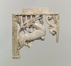Openwork plaque with an oryx eating a plant beside a tree    Period:      Neo-Assyrian  Date:      ca. 9th–8th century B.C.  Geography:      Mesopotamia, Nimrud (ancient Kalhu)  Culture:      Assyrian  Medium:      Ivory  Dimensions:      5 x 4.69 x 0.43 in. (12.7 x 11.91 x 1.09 cm)  Classification:      Ivory/Bone-Relief  Credit Line:      Rogers Fund, 1958  Accession Number:      58.31.3