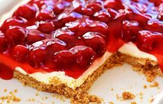 Ingredients:  1 3/4 cups crushed graham cracker crumbs  1/3 cup sugar  1/4 cup melted butter  2 cups whipped dream whipped topping (1 envelope)  1/2 teaspoon vanilla  1 (8 ounce) package cream cheese, softened  1 (28 ounce) can cherry pie filling      Directions:  1 Prepare a