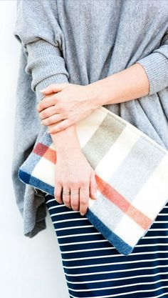 over-sized sweater paired with a knit pencil skirt and wool clutch.