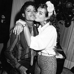 Michael Jackson getting kissed by  Brooke Sheilds