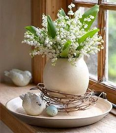 Lily of the Valley so pretty with the bird and egg.
