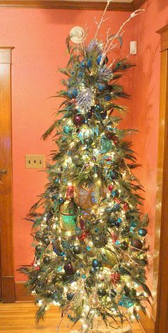 Mine is similar, need more feathers and I want a tree topper of some sort, preferably an angel with matching peacock colors in her dress.