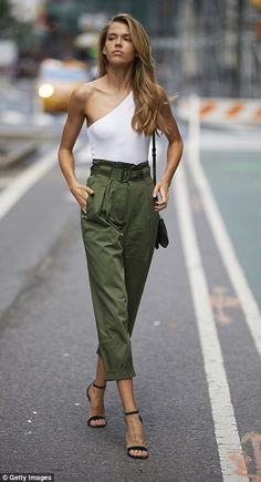 b7f06dd7f4ad6 Australian model Victoria Lee, left, wore olive green pants with a white  one-