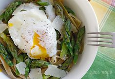 Asparagus and poached eggs over pasta    *Note: ADD several generous sprinklings of lemon juice. It makes it phenomenal. :-)    p.s. I know this looks weird, but it's one of the yummiest dinners ever. The  Pecorino Romano cheese adds so much.