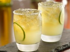 Beergaritas - suppose to be really good with pizza!  Recipe from Betty Crocker (Member-Exclusive Recipe) 1 can (12 oz) frozen limeade concentrate, thawed   1 cup tequila   1/4 cup orange-flavored liqueur   2 bottles (12 oz each) light-colored beer   Crushed ice   8 lime slices