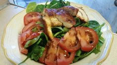 Soyaki infused chicken on a bed of spinach and tomatoes w/some homemade balsamic vinegrette. Nice warm salad.