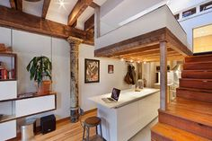 Raised loft bed, use of rustic beams with contemporary features.  Architect Jorge Pena.  Houzz