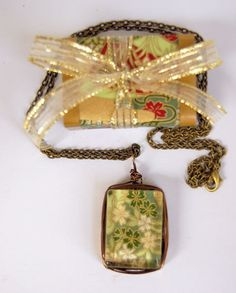 Wire Wrapped Art Pendant in Green ,Gold and Off White   Found in the booth of Its So Me    http://www.bonanza.com/listings/Wire-Wrapped-Art-Pendant-in-Green-Gold-and-Off-White/79072357#  _500-brass-101