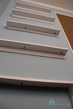 shallow shelving on an entry wall for shoes keys decor books etc