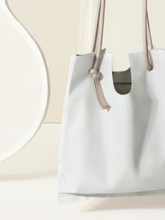 Soft raw-cut leather shopper