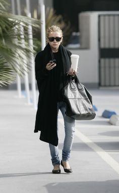 Dress like Ashley Olsen in light denim, a black sweater and a cozy scarf.